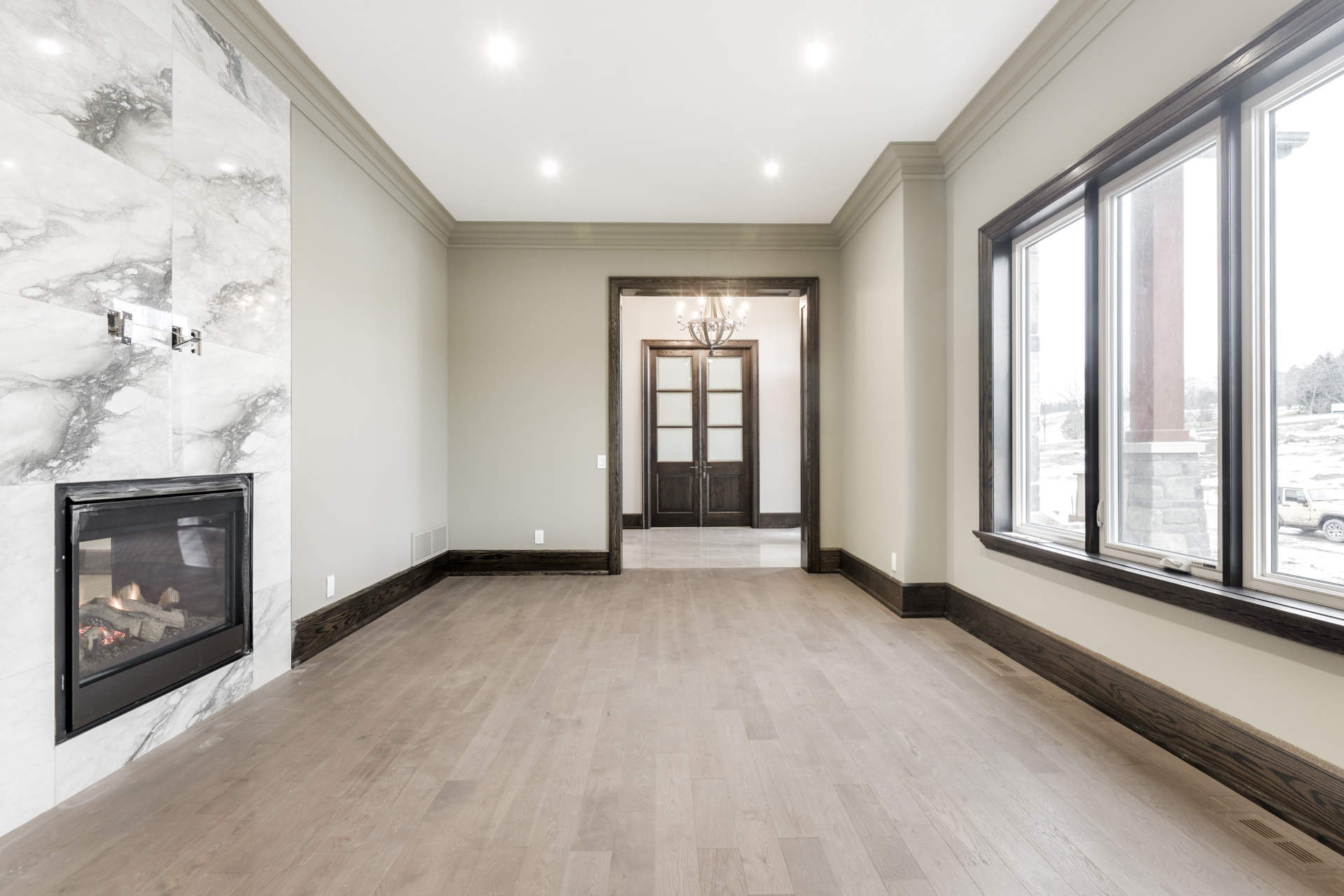 Hall's Lake Estates Luxury Model Home living room with gas fireplace