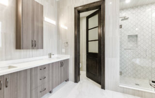 Hall's Lake Estates Luxury Model Home Bathroom Vanity Cabinets with Granite counter tops.
