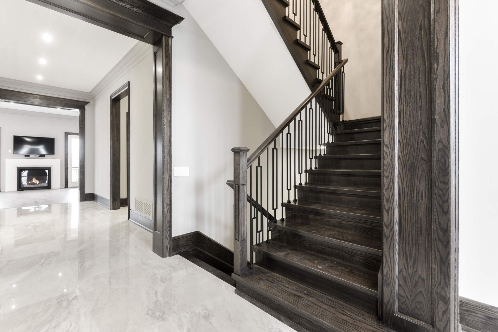 Hall's Lake Estates Luxury Model Home Hand Crafted Oak stairway